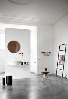TOWEL LADDER, BLACK/DARK ASH from Skandium   www.skandium.com Minimal bathroom with polished concrete floor.