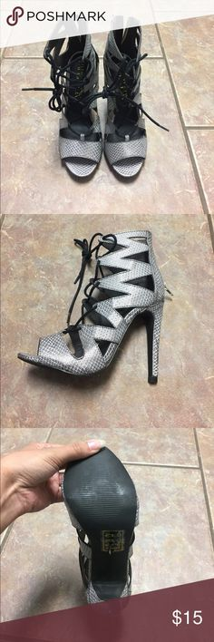 Heels Silver/gray and black snakeskin patterned heels. Lace detail in front and zipper in the back. Never worn. Paper Fox Shoes Heels