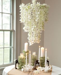 A chandelier could have strands of orchids draping from the frame. The amount of orchids draped would be dependent on your budget for this design. Option 2