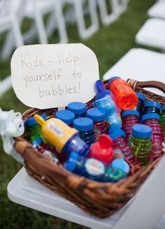 At an outdoor reception, reserve some space at the side for a bubble station. The table can include a container of bubbles for each child or tubs of soapy water and large wands for even bigger bubbles! Photo by Kristin Moore Photo