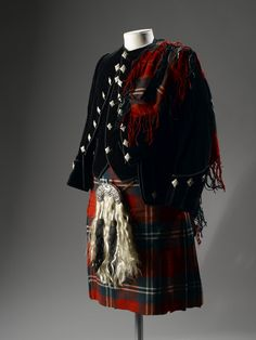 Boy's kilt of red, green and white woollen tartan having buttons at the waist, tape belt loops at the back and a half lining, part of a boy's Highland dress outfit worn by Alexander Allen, Ayrshire: Scottish, c. 1910 - 1915