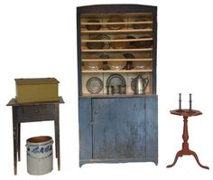 """Early 19th century Cumberland County North Carolina open top Pewter Cupboard with original blue and  white paint, ever thing is original including the beautiful mushroom knob, and spinner. circa 1820-1840 Measurements are: 37"""" 1/2 wide  16"""" deep 77 1/2"""" tall"""