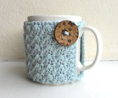 mug cozy. These are too cute! Guess I'd have to learn how to crochet first.
