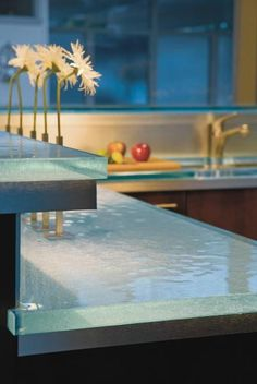 I really love the look of these glass countertops. And they can be eco friendly…