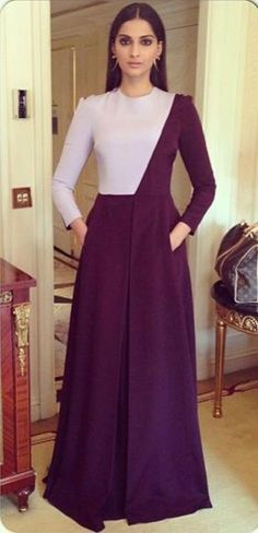 Sonam cut a fine figure in a long-sleeved, colourblocked Barbara Casasola dress with smoky eyes and hoop earrings.