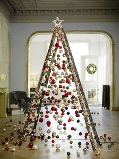 Ladder Christmas Tree is very fun and you can decorate it with your imagination. Although lots people love a traditional tree,they may also like Ladder Christmas Tree. You can save … Ladder Christmas Tree, Unusual Christmas Trees, Alternative Christmas Tree, Christmas Tree Decorations, Diy Christmas Room Decor, Carnival Decorations, Creative Christmas Trees, Unique Christmas Ornaments, Christmas Windows