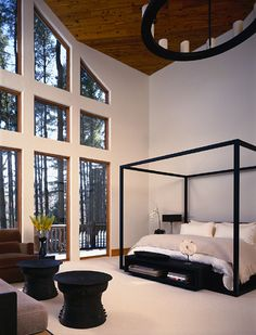 Modern bedroom with floor to ceiling windows. I love this!! Except it should be mirrors ;-)