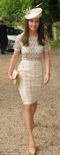 Pippa wearing a dress by Tory Burch Adelaide dress and a hat by Whiteley Fischer a clutch by Tory Burch and heels by Kate Spade.