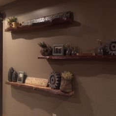 Floating Natural Log Shelves and Antique Barn Wood Door all custom built by Kevin Reed @ Creatively Kustomized.