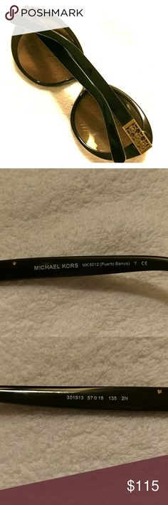 Authentic Michael Kors sunglasses Michael Kors Puerto Banus sunglasses. Discreet Michael Kors signature on the temples, in gold tone. Dimensions: 57mm-16mm-135mm. Michael Kors etched lenses, classic cateye frames, and snake print lens corners. In excellent condition. Michael Kors Accessories Sunglasses
