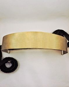 The Hammered Brass Belt is the perfect piece to be worn high on the waist or low to create a flattering hourglass figure and cinch loose silhouettes. This style is made from flexible brass with a matte gold finish. The brass is hammered out by hand and the braided black belt is handmade in the refugee villages and camps by women artisans. The perfect piece to complement any outfit and accent the brass bracelets and rings you wear with it. The braid is designed to be tied in the back but can…