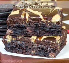Peanut Butter Swirl Ganache Brownies. Fudgy, dense chocolate brownies stuffed with oreos and topped with a soft chocolate and peanut butter swirled ganache.
