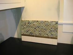 Glass Tile Backsplash....Steve & April, this is subway tile WITH glass tile. I could see this working too