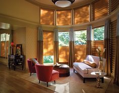 The luxurious fabrics and soft folds of Vignette® Modern Roman Shades in this living room help create warm beautiful windows with the added benefit of enhanced child safety. ♦ Hunter Douglas window treatments