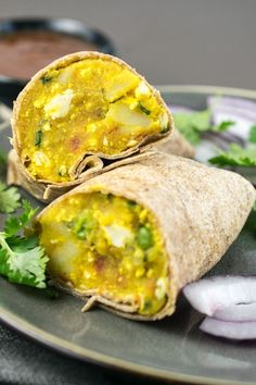 Recreate Amy's Indian Samosa Wraps at home with these easy, healthy and cheap samosa wraps! Spiced potatoes, tofu and peas in a soft tortilla.