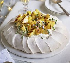 Pile whipped cream and charred pineapple on a meringue base to create a stunning dinner party dessert which you can make ahead paleo dessert pineapple Bbc Good Food Recipes, Cooking Recipes, Drink Recipes, Dessert Recipes, Dinner Party Desserts, Summer Desserts, Pavlova Recipe, Paleo Dessert, Tray Bakes