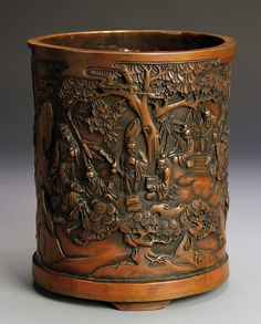 China, 18/19th C., bronze brush pot with an intricately formed scene of seven wise men under trees, Qianlong mark on the base. Width 6 3/4 in., Height 5 1/2 in.