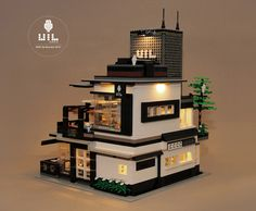 Brandon Wyc is back with this amazing cafe MOC that makes use of clever lighting and solid design aesthetics to evoke a sense of warm tranquility. Legos, Lego Lego, Lego Minecraft, Lego Batman, Minecraft Buildings, Lego Star, Modern House Floor Plans, Lego Mecha, Lego Modular