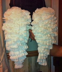 DIY Angel Wings from Coffee Filters,   Panty Hose, and Hangers -- Bend 2 wire hangers into wing shape. Twist the hangers together or use zip ties to complete the frame. Stretch panty hose over frame and tie loose ends in the middle. Fold coffee filters into quarters and secure with hot glue. Starting at the bottom, glue folded filters onto the wings and work towards the top. Fill in any bare spots. At the top, fold filters in half to cover the wires. Hang with cords fastened like a backpack.