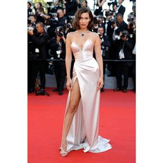 Bella Hadid Strapless Dress ❤ liked on Polyvore featuring dresses, red plunge dress, red slit dress, sweetheart dress, sweetheart neckline strapless dress and couture dresses