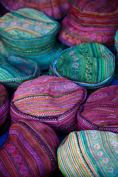 Traditional, colourful and finely embroidered ethnic Flower H'mong hats for sale at Can Cau Market.