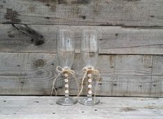 Rustic Wedding Toasting Glasses with Twine and Flowers, Rustic Champagne Flutes, Bride and Groom Wine Glasses, by LittleZebrasBoutique on Etsy https://www.etsy.com/listing/215081090/rustic-wedding-toasting-glasses-with