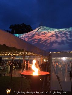 Flaming torchiere outside the entrance to a beautiful sailcloth tent lit with foliage gobos. Wedding Tent Lighting, Tent Wedding, Sailing Outfit, Window Wall, Tents, Lighting Design, Getting Married, Aurora, Entrance