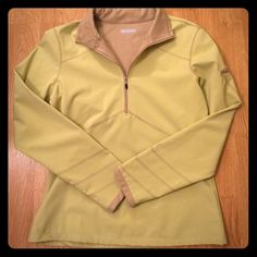 Althleta pullover This pullover definitely keeps you warm. Light lime green with brown trim. Small pocket on left sleeve. Worn maybe a handful of time. Athleta Jackets & Coats