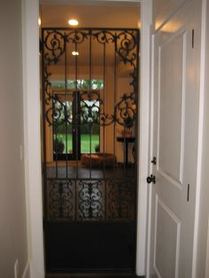 Wrought iron door to separate mud room from hearth room to keep dogs out of main house