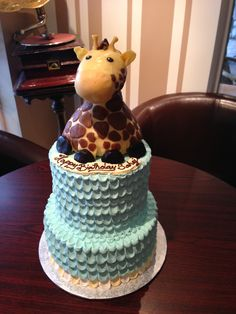 2-tier light blue petal pull buttercream birthday cake with hand sculpted edible giraffe on top.  White Rock BC Nut-free Bakery