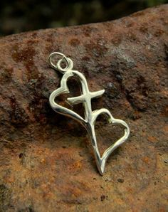 silver two hearts join by a cross.