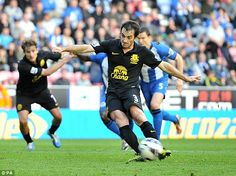 6 October 2012 Leighton Baines rescues a point at Wigan with a late penalty after Kevin Mirallas had been brought down