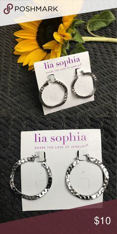 Lia Sophia silver hoops Brand new never worn Lia Sophia silver hoop earrings. Super cute! Classic style! Lia Sophia Jewelry Earrings