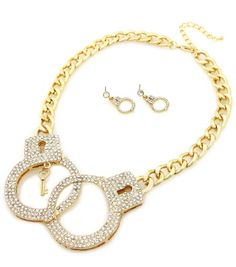 It's hard not to get caught up over this rhinestone encrusted gold handcuff necklace.