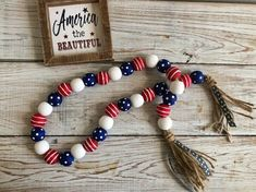 Check out our of july wooden decor selection for the very best in unique or custom, handmade pieces from our shops. Wood Bead Garland, Diy Garland, Beaded Garland, Garlands, Garland Ideas, Christmas Bead Garland, Star Garland, Christmas Tree, Fourth Of July Decor