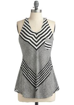 just love this... would look great tucked into skirts and belted, belted over fitted jeans to create a peplum effect, or casual with short shorts and a colorful necklace.