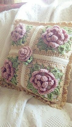 Crochet pillow finished. Love cabbage roses.