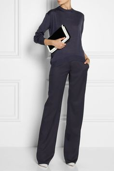 This outfit is a beautiful ensemble. The clean cut of the pants and how it perfectly lays on the shoes are classy.