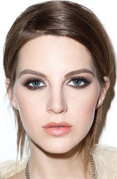Soft smoky eye, pink/peachy lip gloss, blush in the hollows of the cheeks