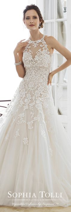 Sophia Tolli Y11866 Adonia - Offering two looks in one, Adonia is a two-piece strapless misty tulle A-line gown offering a deep sweetheart neckline with a sheer modesty panel, and beaded lace appliqués that generously adorn the dropped waist bodice flowing down the skirt to a clean tulle hem finish. A back zipper trimmed with diamante buttons and a chapel train complete the look. A removable sheer tulle halter shoulder piece with beaded lace is included. Standard removable spaghetti and…