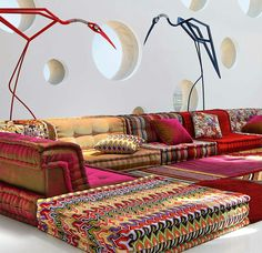 I like the eclectic fabric and texture. You could use certain cushions. NOt all. Roche Bobois