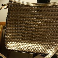Great Bag Just so these old eyes don't lie, I see the gold both   shiney and matte not silver my husband confirmed sweet poshers. It's that gold that's not so gold comprende' very clean so please don't buy and say oh its silver cause it ain't hahahah great shape like new no damage preloved but no stains. Two sections and one zipper pocket also zips closed. Bags Shoulder Bags
