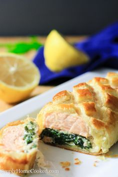Salmon Wellington-Seasoned salmon placed on a bed of cheesy sauteed spinach, wrapped in puff pastry, and baked to perfection. Salmon Recipes, Fish Recipes, Seafood Recipes, Great Recipes, Favorite Recipes, Pasta Recipes, Recipies, Salmon Wellington Recipe, Wellington Food