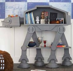 Star Wars AT-AT Bookshelf Cuts An Imperial Colossus Down To Size. As many of these fine nerdy treasures do, the Star Wars AT-AT Bookshelf from Pottery Barn Kids got us thinking. Imagine civil war across a galaxy f. Star Wars Bedroom, Star Wars Nursery, Star Wars Bedding, Geek Bedroom, At At Walker, Star Wars Kindergarten, Boy Room, Kids Room, Star Wars Furniture