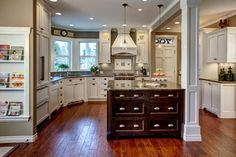 Love the gray subway tile and the combo of white cabinets with a stained island.