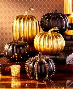 """Create a glamorous display for Halloween with Designer Pumpkins. Each pumpkin features elements such as spikes, studs or shiny gold finishes. Tall Gold, 7-1/2"""""""