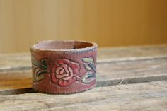this might be my favorite cuff yet!  brown leather cuff with flowers ... CUSTOMIZED