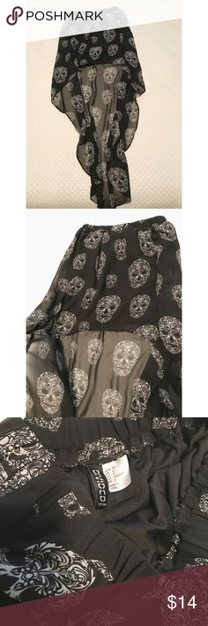 Candy Skull High-Low Skirt Are you the girl who celebrates Halloween all year round? Is going to Día de los Muertos in Mexico your dream vacation? Then look no further, because this is the perfect skirt for you! Very lightweight and airy high-low black sheer skirt with amazing sugar skull pattern and attached miniskirt liner. Size is a US 4, but with the elastic waistband, could probably fit smaller or larger! Divided Skirts High Low