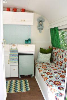 Vintage Caravan Camper Makeover - seating kitchen cupboards