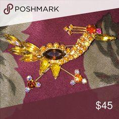 "Vintage Figural Road Runner brooch Vintage figural road runner brooch 1950s. Measures 2 3/4 x 1 1/2"". Orange amber yellow and brown rhinestones Vintage Jewelry Brooches"